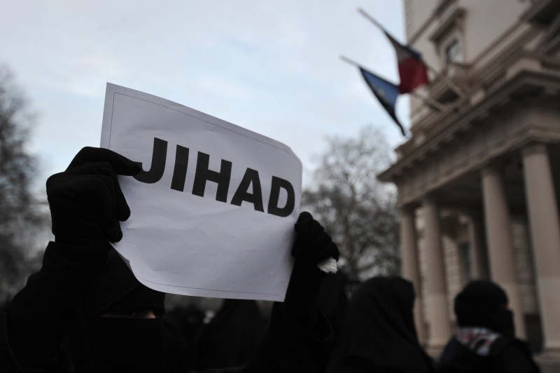 "A Muslim protester holds up a sign that reads ""Jihad"" during a demonstration in response to French military action in Mali outside the French embassy in central London on January 12, 2013. Around 50 Muslim protesters shouted slogans and waved signs as they demonstrated outside the French embassy against French intervention in Mali. France sent troops on January 11 to help Malian forces hold back a rebel advance towards the capital Bamako, and on January 12 Paris announced that a French military pilot had been killed. AFP PHOTO / CARL COURT        (Photo credit should read CARL COURT/AFP/Getty Images)"