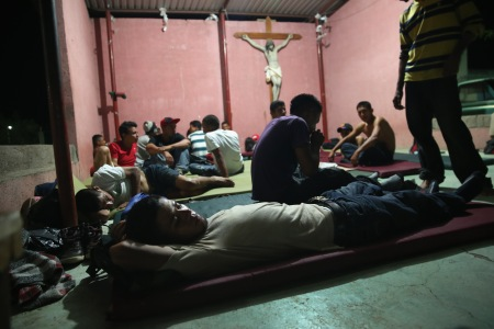 IXTEPEC, MEXICO - AUGUST 04: Migrants sleep on mats outside at the Hermanos en el Camino (Brothers in the Road) shelter on August 4, 2013 in Ixtepec, Mexico. The shelter, founded in 2007 by Catholic Father Alejandro Solalinde Guerra, houses and feeds immigants, most from Central America, during a stop on their train route through Mexico towards the U.S. border. Thousands of migrants ride atop the trains during their long and perilous journey through Mexico. Many of the immigrants are robbed or assaulted by gangs who control the train tops, while others fall asleep and tumble down, losing limbs or perishing under the wheels of the trains. Only a fraction of the immigrants who start the journey will arrive safely on their first attempt to illegally enter the United States. (Photo by John Moore/Getty Images)