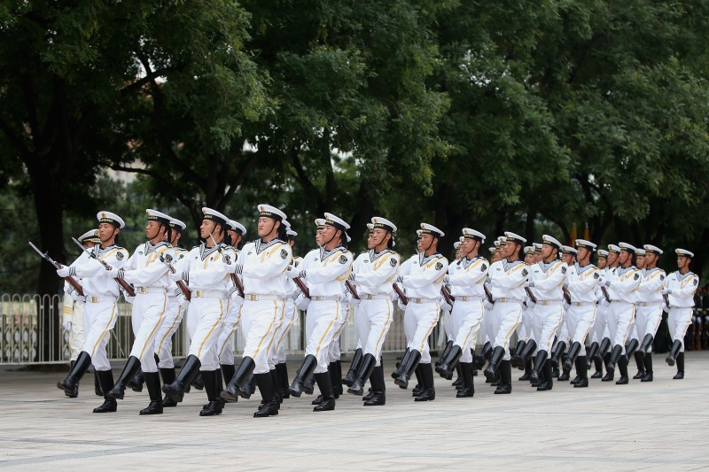 BEIJING, CHINA - SEPTEMBER 16:  Chinese People's Liberation Army navy soldiers of a guard of honor rehearse before a welcoming ceremony for Bahrain's King Hamad Bin Eisa Al Khalifa outside the Great Hall of People on September 16, 2013 in Beijing, China. At the invitation of Chinese President Xi Jinping, King Hamad Bin Isa Al Khalifa of Bahrain paid a state visit to China from September 14 to 16.  (Photo by Feng Li/Getty Images)