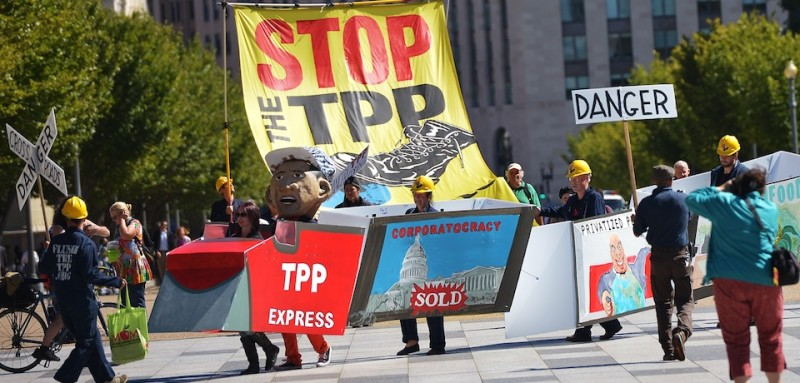 Demonstrators protesting against the Trans-Pacific Partnership (TPP) are seen on Pennsylvania Avenue, near the White House, on September 24, 2013 in Washington, DC. The TPP is a proposed free trade agreement being negotiated by  Australia, Brunei, Canada, Chile, Japan, Malaysia, Mexico, New Zealand, Peru, Singapore, the United States and Vietnam. AFP PHOTO/Mandel NGAN        (Photo credit should read MANDEL NGAN/AFP/Getty Images)