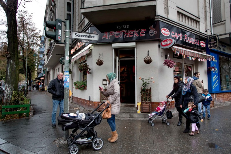 BERLIN, GERMANY - NOVEMBER 02:  Women pushing baby carriages in front of a Albanian pub in Sonnenallee in Neukoelln district on November 02, 2013 in Berlin, Germany. The pub is named after the Albanian village Radush in Macedonia. The men came to Germany, along with around two hundred other families from the same village. According to recently published statistics, 7.2 million foreigners were living in Germany by the end of 2012, which is the highest number ever recorded. Of those 80% are from countries in the European Union, while the rest come primarily from Turkey, Russia, the former Soviet states and Arab countries.  (Photo by Carsten Koall/Getty Images)