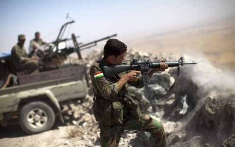 An Iraqi Kurdish Peshmerga fighter fires at Islamic-State (IS) militant positions, from his position on the top of Mount Zardak, a strategic point taken 3 days ago, about 25 kilometres east of Mosul on September 9,2014. Kurdish forces in the north have been bolstered by US strikes and took control of Mount Zardak, a strategic site that provides a commanding view of the surrounding area, a senior US officer said. AFP PHOTO/ JM LOPEZ (Photo credit should read JM LOPEZ/AFP/Getty Images)
