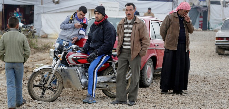 ZAHLE, LEBANON - DECEMBER 09: Inhabitants of an informal tented settlement of Syrian refugees on December 09, 2014 in Zahle, Lebanon. The ongoing civil war in Syria continues to force masses of Syrians into neighboring Lebanon. (Photo by )