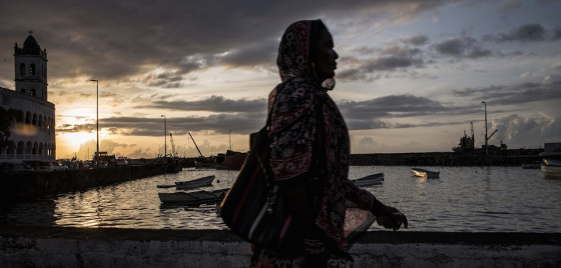 A Comoran woman walks along the waterfront in Moroni on February 21, 2015 on the eve of the second round of the legislative elections. The second phase of the Comoros legislative election will be a face-off between the party of President Ikililou Dhoinine and his predecessor Ahmed Abdallah Sambi.   AFP PHOTO / MARCO LONGARI        (Photo credit should read MARCO LONGARI/AFP/Getty Images)