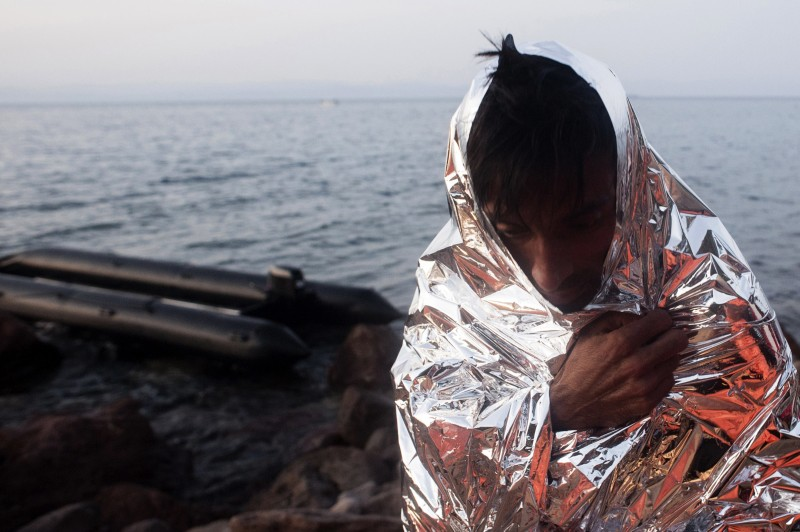A refugee is wrapped in a survival blanket upon his arrival on the shore of Sykamias beach, west of the port of Mytilene on the Greek Island of Lesbos, on September 20, 2015, after crossing the Aegean sea from Turkey, on the Greek island of Lesbos. Over half a million migrants have crossed the European Union's border so far this year, up from 280,000 in 2014, the bloc's Frontex border agency said on September 15, 2015 -- but warned some people may have been counted twice.  AFP PHOTO / IAKOVOS HATZISTAVROU        (Photo credit should read IAKOVOS HATZISTAVROU/AFP/Getty Images)