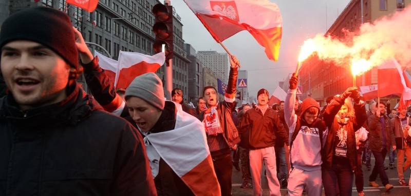 Demonstrators wave the Polish flag during the annual march commemorates Poland's National Independence Day in Warsaw on November 11, 2015. Poland's National Independence Day commemorates the anniversary of the Restoration of a Polish State in 1918. AFP PHOTO/JANEK SKARZYNSKI .        (Photo credit should read JANEK SKARZYNSKI/AFP/Getty Images)