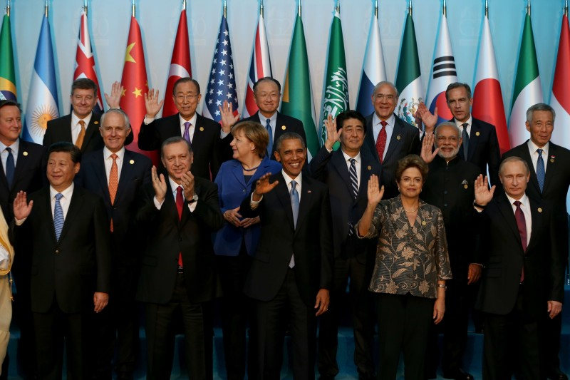 ANTALYA, TURKEY - NOVEMBER 15:  (Front row L-R) Chinese President Xi Jinping, Turkish President Recep Tayyip Erdogan, US President Barack Obama, Brazilian President Dilma Rousseff, Russian President Vladimir Putin, (2nd Row L-R) British Prime Minister David Cameron, Australian Prime Minister Malcolm Turnbull, German Chancellor Angela Merkel, Japanese Prime Minister Shinzo Abe, Indian Prime Minister Narendra Modi, Singapore's Prime Minister Lee Hsien Loong, (3rd row L-R) Guy Ryder, Director General of International Labour Organisation (ILO), UN Secretary-General Ban Ki-moon, World Bank President Jim Yong Kim, Angel Gurria (L), Secretary-General of Organization for Economic Co-operation and Development (OECD), Bank of England Governor and Financial Stability Board (FSB) Chairman Mark Carney pose for a family photo during the G20 Turkey Leaders Summit on November 15, 2015 in Antalya, Turkey. (Photo by Berk Ozkan/Anadolu Agency/Getty Images)