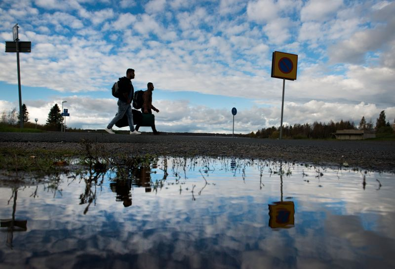 TORNIO, FINLAND  - OCTOBER 4:   Immigrants, mostly from Iraq, walk from a bus station in Sweden to Finland to a makeshift customs checkpoint in the northern border in Tornio, Finland on October 4, 2015.   Most have journey a week or two, through multiple countries including Sweden who put them on a train, then a bus to the Finnish border.  There are families with small children, some women traveling alone but mostly there are young men from the Baghdad area.  (Photo by Linda Davidson/The Washington Post)