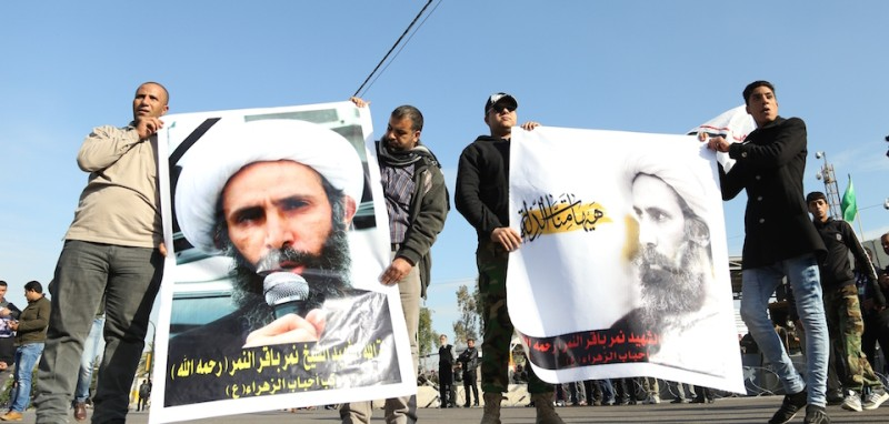 BAGHDAD, IRAQ - JANUARY 4: Members of Sadrist movement hold posters of Nimr Baqir al-Nimr during a protest against the execution of prominent Saudi Shia cleric Nimr Baqir al-Nimr by Saudi authorities, in Baghdad on January 4, 2016. (Photo by )