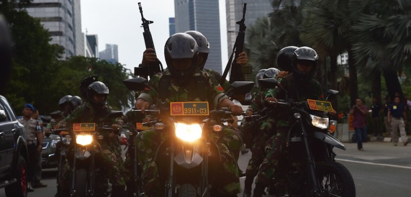 TOPSHOT - Indonesian armed military patrol the area near cafe after a series of blasts hit Jakarta on January 14, 2016. An attack on Jakarta is over and no more perpertators are at large, police said on January 14, after gunfire and explosions left seven dead in the Indonesian capital. AFP PHOTO / Bay ISMOYO / AFP / BAY ISMOYO        (Photo credit should read BAY ISMOYO/AFP/Getty Images)