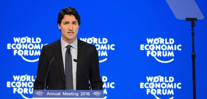 Canadian Prime Minister Justin Trudeau delivers a speech during a session of the World Economic Forum (WEF) annual meeting in Davos, on January 20, 2016. A string of jihadist attacks and rising risks to the global economy overshadow the opening of the annual gathering of the world's rich and powerful in a snow-blanketed Swiss ski resort. Even as heads of state, billionaires and Hollywood megastar Leonardo DiCaprio were arriving, the International Monetary Fund (IMF) sounded the alarm on January 19, 2016 about perils in the major emerging market economies and lowered its outlook for global economic growth this year. / AFP / FABRICE COFFRINI        (Photo credit should read FABRICE COFFRINI/AFP/Getty Images)