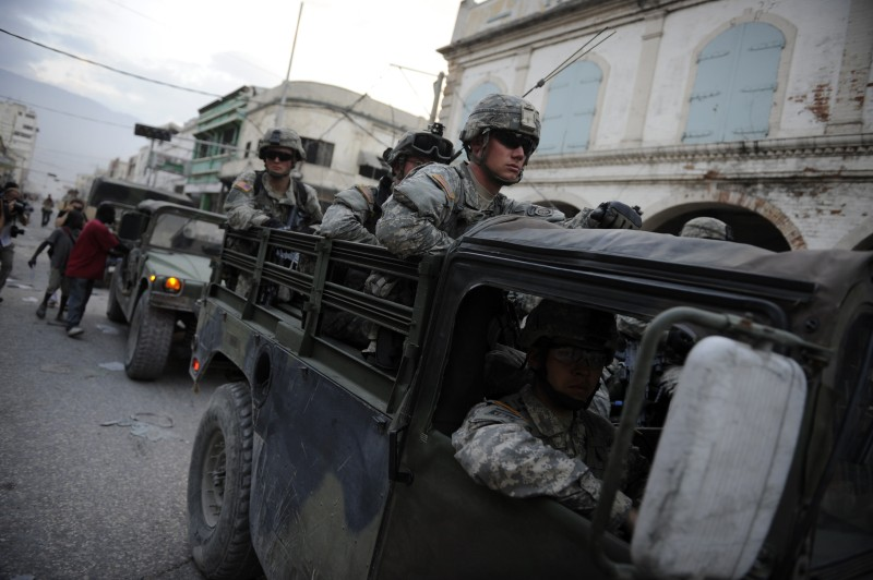 """American soldiers move on a street  January 19, 2010. January 19, 2010 in Port-au-Prince.  In all, """"approximately 11,000 U.S. military personnel are currently supporting task force operations within Haiti and from US Navy and Coast Guard vessels off shore,"""" US Southern Command said on its website January 19, 2010.  AFP PHOTO / OLIVIER LABAN-MATTEI (Photo credit should read Olivier Laban mattei/AFP/Getty Images)"""