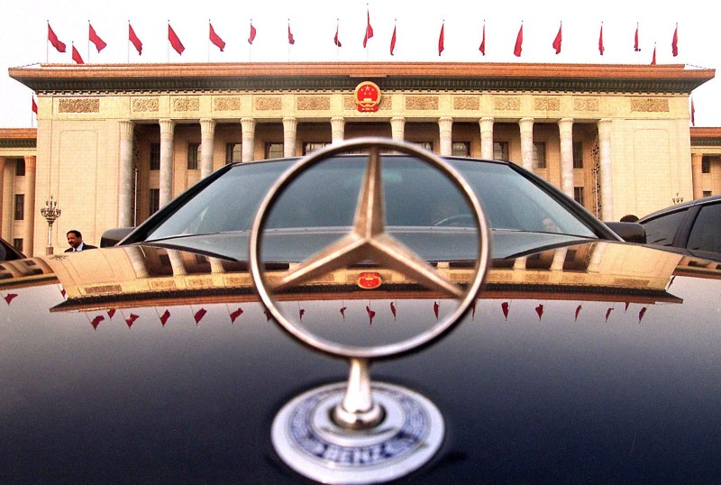 A luxury car driven by a Chinese official is parked in front of the Great Hall of the People during a session of the National People's Congress at the Great Hall of the People in Beijing, 10 March 2001.  China's top judicial officials said Friday they were winning the war against graft and vowed to step up the 'strike hard' campaign against corruption plaguing the country's government.      AFP PHOTO/Stephen SHAVER (Photo credit should read STEPHEN SHAVER/AFP/Getty Images)