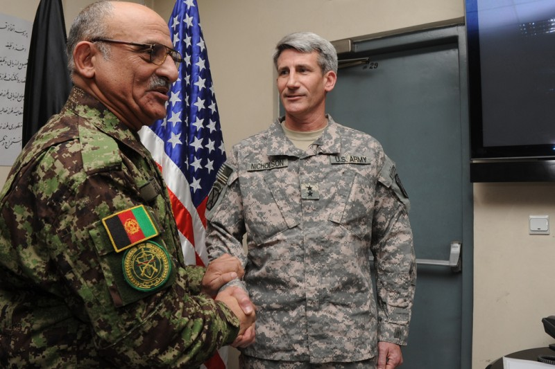 "Lt. Gen. Shir Mohammad Karimi, General Chief of Staff of Operations for the Afghan National Army, congratulates newly-promoted Maj. Gen. John ""Mick"" Nicholson after affixing his two-star rank to his uniform. Nicholson, deputy chief of staff for operations with the International Security Assistance Force, asked Karimi to participate in his promotion as a sign of partnership between coalition and Afghan military leaders. Nicholson's promotion took place at the Ministry of Defense in Kabul before a senior leader security meeting. (Photo by U.S. Army Staff Sgt. Lorie Jewell) (Released)"