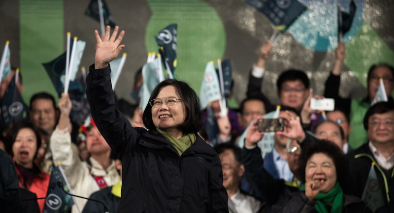 Democratic Progressive Party (DPP) presidential candidate Tsai Ing-wen (C) celebrates her victory inTaipei on January 15, 2016.  Voters in Taiwan elected a Beijing-sceptic president in a dramatic democratic journey, carving their own political path against China's wishes. AFP PHOTO / Philippe Lopez / AFP / PHILIPPE LOPEZ        (Photo credit should read PHILIPPE LOPEZ/AFP/Getty Images)