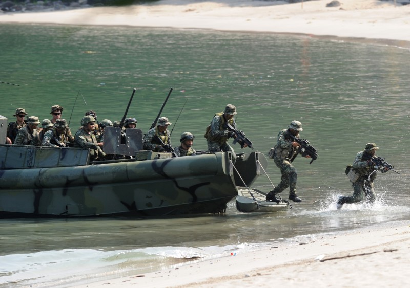 "Philippine Marines simulate a beach landing exercise as part of their annual joint naval exercises with the US at a marine base in Ternate, Cavite province, west of Manila on October 8, 2015.  The Philippines in late August asked the US to provide military ""assistance"" in resupplying and rotating Manila's forces in the South China Sea because they face harassment from regional power China, a military spokesman said .     AFP PHOTO / TED ALJIBE        (Photo credit should read TED ALJIBE/AFP/Getty Images)"