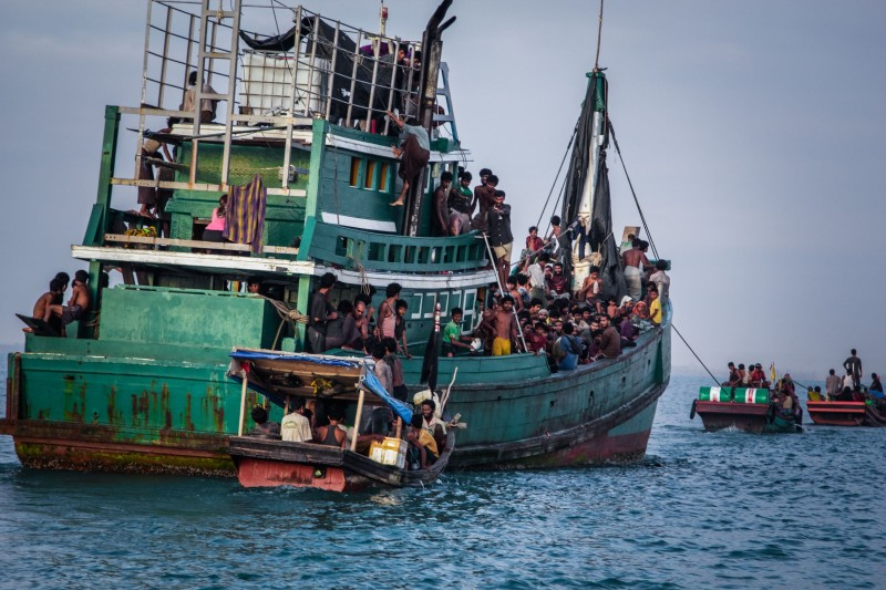 In this photo taken on May 20, 2015 shows Rohingya migrants resting on a boat off the coast near Kuala Simpang Tiga in Indonesia's East Aceh district of Aceh province before being rescued. Indonesia's foreign minister demanded answers from Canberra about claims Australian officials paid thousands of dollars to turn a boat back to Indonesia after Prime Minister Tony Abbott refused to deny the allegations. AFP PHOTO / JANUAR        (Photo credit should read JANUAR/AFP/Getty Images)