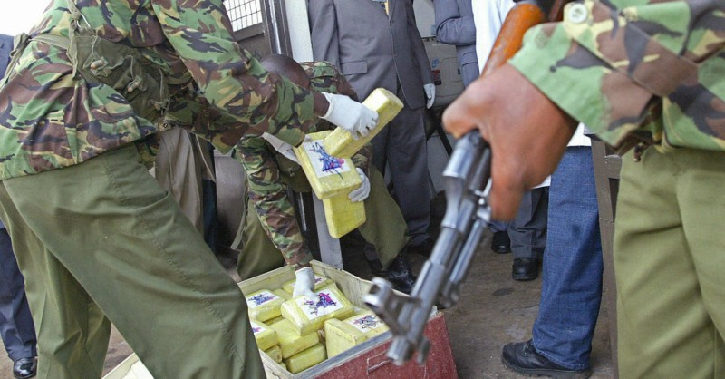Nairobi, KENYA:  Kenyan police officers load part of 1.2 tonnes of cocaine before it is incinerated 31 March 2006 in Nairobi. Kenyan authorities destroyed about 1.2 tonnes of cocaine seized in 2004, a record haul that had become the subject of corruption and evidence-tampering allegations. AFP PHOTO/TONY KARUMBA  (Photo credit should read TONY KARUMBA/AFP/Getty Images)