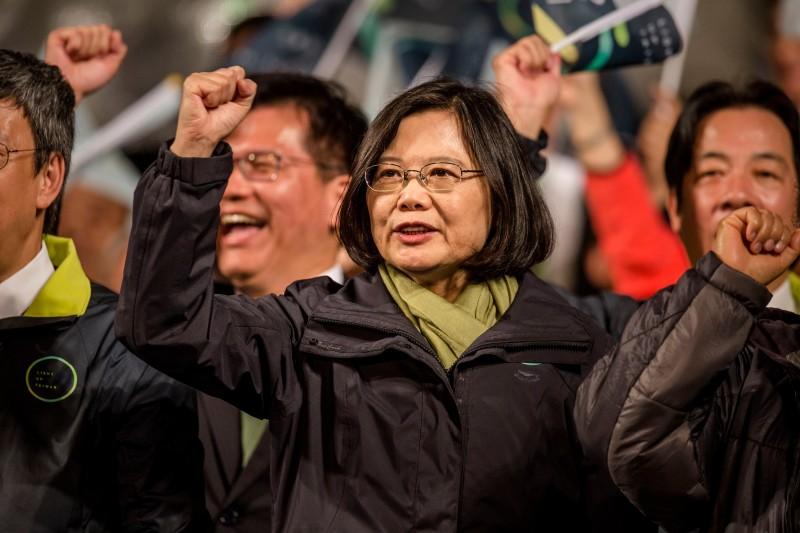TAIPEI, TAIWAN - JANUARY 16: Tsai Ing-wen (C), waves to supporters at DPP headquarters after her election victory on January 16, 2016 in Taipei, Taiwan. Tsai Ing-wen, the chairwoman of the opposition Democratic Progressive Party, has won the presidential election to become the Taiwan's first female president.  (Photo by Ulet Ifansasti/Getty Images)
