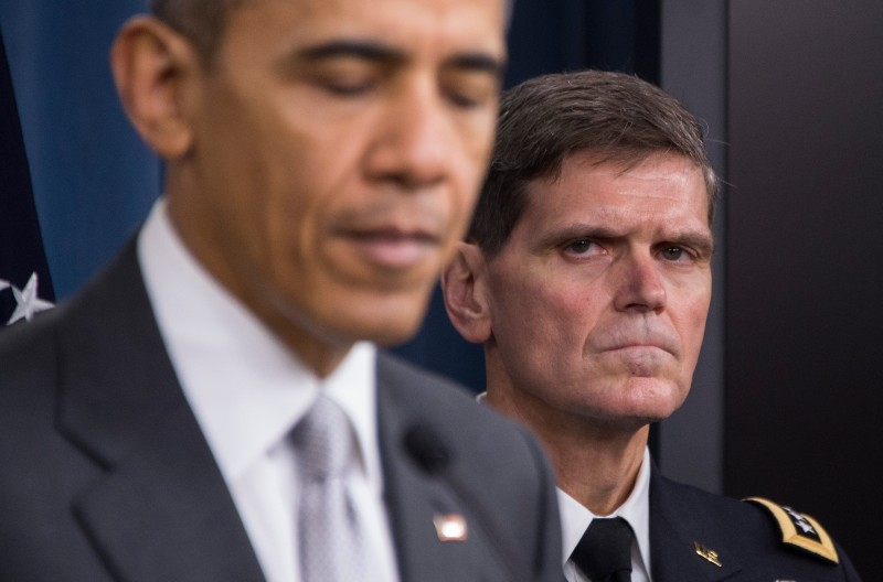 US Special Operations Commander General Joseph Votel (R) listens as US President Barack Obama (L) delivers a statement to reporters following a National Security Council meeting on the counter-ISIL at the Pentagon in Washington, DC, December 14, 2015.  AFP PHOTO / JIM WATSON / AFP / JIM WATSON        (Photo credit should read JIM WATSON/AFP/Getty Images)