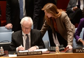 US Ambassador to the UN Samantha Power talks with her Russian counterpart Vitaly Churkin prior to a vote on a resolution on Ukraine during a UN Security Council emergency meeting at United Nations headquarters in New York on March 15, 2014. Russia vetoed a Western-backed resolution condemning the Crimea referendum at a UN Security Council emergency vote but China abstained, isolating Moscow further on the Ukraine crisis. The draft resolution, which says Sunday's referendum would have no validity, got 13 votes in the 15-member Council. But it was rejected when permanent member Russia exercised its veto.   AFP PHOTO/Emmanuel Dunand        (Photo credit should read EMMANUEL DUNAND/AFP/Getty Images)