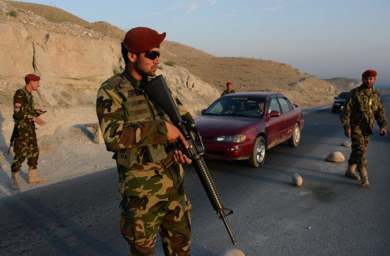 Afghan National Army (ANA) soldiers keep watch at a checkpoint ahead of the upcoming Eid Al-Fitr celebrations, on the outskirts of Jalalabad city in Nangarhar province on July 15, 2015. Afghan Muslims, like millions of Muslims around the world, are observing the holy month of Ramadan by fasting from dawn until dusk. AFP PHOTO/ Noorullah Shirzada        (Photo credit should read Noorullah Shirzada/AFP/Getty Images)