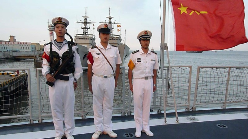 Chinese sailors stand onboard a frigate berthed in Shanghai on September 22, 2011. The Chinese navy is playing a key role in Beijing's move to become a major global military power, as demonstrated by the recent release of the first Chinese aircraft carrier.   AFP PHOTO/GUILLAUME KLEIN (Photo credit should read GUILLAUME KLEIN/AFP/Getty Images)