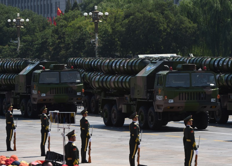 Chinese People's Liberation Army HQ-9 surface to air missile launchers are seen during a military parade at Tiananmen Square in Beijing on September 3, 2015, to mark the 70th anniversary of victory over Japan and the end of World War II. China kicked off a huge military ceremony marking the 70th anniversary of Japan's defeat in World War II on September 3, as major Western leaders stayed away. AFP PHOTO / GREG BAKER        (Photo credit should read GREG BAKER/AFP/Getty Images)