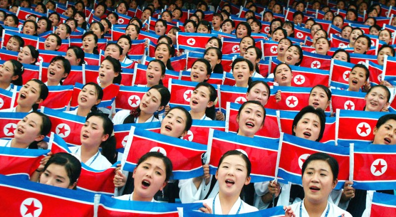 DAEGU, SOUTH KOREA - AUGUST 21:  North Korean dancers and musicians wave North Korean flags during the opening ceremony of the 22nd Summer Universiade Games August 21, 2003 in Daegu, South Korea. North Korea had threatened to boycott the games because of anti-North Korea rallies, but decided to participate after an expression of regret from South Korea's President Roh Moo-hyun. The Summer University Games are to be held August 21-31.  (Photo by Chung Sung-Jun/Getty Images)