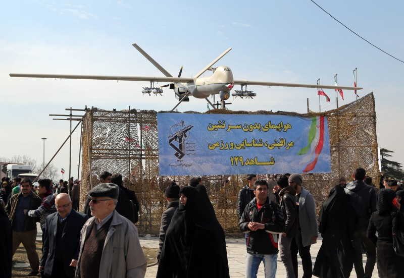 "Iranians walk past Iran's Shahed 129 drone displayed during celebrations in Tehran to mark the 37th anniversary of the Islamic revolution on February 11, 2016.    Iranians waved ""Death to America"" banners and took selfies with a ballistic missile as they marked 37 years since the Islamic revolution, weeks after Iran finalised a nuclear deal with world powers.  / AFP / ATTA KENARE        (Photo credit should read ATTA KENARE/AFP/Getty Images)"