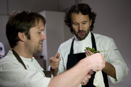 "Italian chef Carlo Cracco (R) and Danish chef Rene Redzepi taste ingredients during the ""Fooding"" event in Milan on October 15, 2010. AFP PHOTO / GIUSEPPE CACACE (Photo credit should read GIUSEPPE CACACE/AFP/Getty Images)"