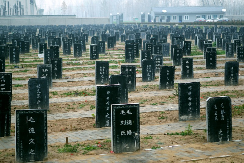 "This picture taken on November 25, 2012 shows tombstones at a public cemetery that was built for the ""flatten graves to return farmland"" campaign in suburb Zhoukou, central China's Henan province. Zhoukou has halted a campaign to clear graves for farmland after the demolition of more than two million tombs sparked outrage in a country where ancestors are traditionally held in deep respect. CHINA OUT     AFP PHOTO        (Photo credit should read AFP/AFP/Getty Images)"