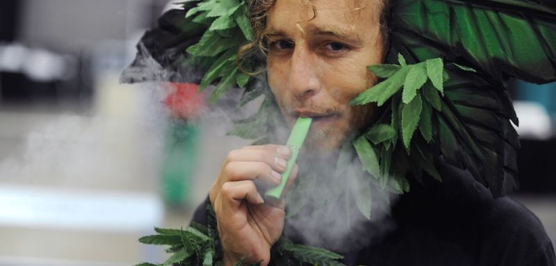 A man calling himself Henry Hemp inhales marijuana using a vaporizer pen at HempCon medical marijuana show, May 24, 2013 at the Los Angeles Convention Center. Thousands of marijuana enthusiasts gathered for the three-day event for exhibits of medical marijuana dispensaries, collectives, evaluation services, legal services and equipment and accessories. Under California state law, people suffering from chronic diseases have the right to grow, buy and use marijuana for medical purposes when recommended by a doctor. In 2003 the Medical Marijuana Protection Act, established an identification card system for medical marijuana patients.      AFP PHOTO / ROBYN BECK        (Photo credit should read ROBYN BECK/AFP/Getty Images)