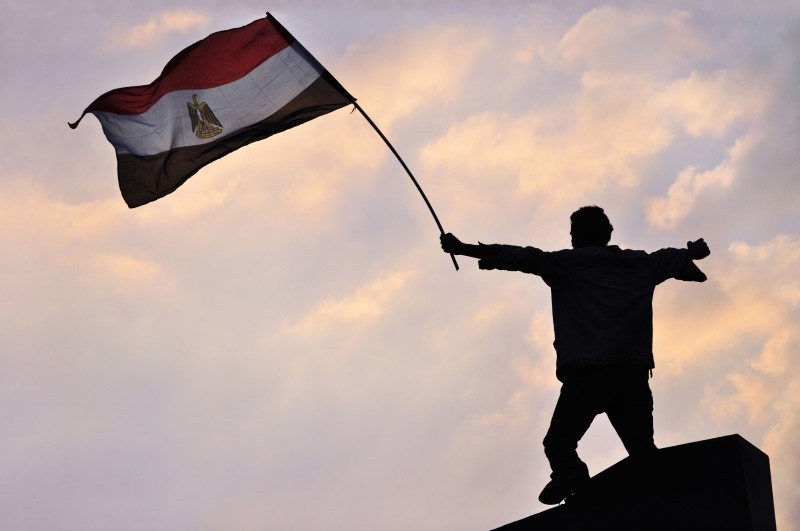 [UNVERIFIED CONTENT] CAIRO, EGYPT - FEBRUARY 8: An Egyptian protester waves the Egyptian flag during protests in Tahrir Square on February 8, 2011 in Cairo, Egypt. The eighteen-day uprising led to the resignation of Hosni Mubarak on February 11, 2011.  (Photo by Jonathan Rashad)
