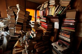 SAN DIEGO, CA - APRIL 8: Books sit stacked in a bedroom at a hoarders home in on April 8, 2011in San Diego, California. Martin's mother was a hoarder and recenty passed away leaving her son Greg and his wife Sidney to clean the place out.  (Photo by Sandy Huffaker/Getty Images for YOU Magazine)