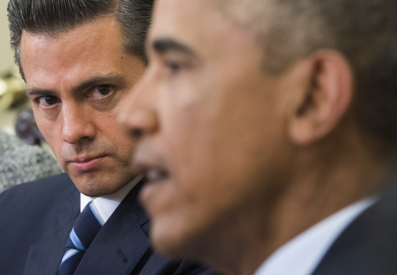 US President Barack Obama meets with Mexican President Enrique Pena Nieto in the Oval Office of the White House in Washington, DC, January 6, 2015. AFP PHOTO / SAUL LOEB        (Photo credit should read SAUL LOEB/AFP/Getty Images)