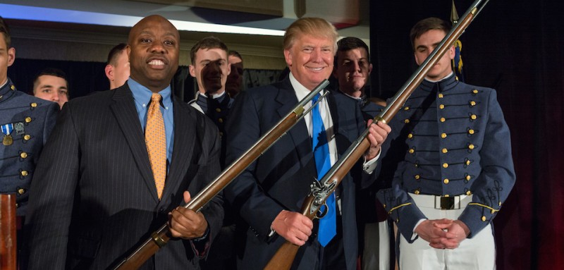 CHARLESTON, SC - FEBRUARY 22:  Reality TV host and New York real estate mogul Donald Trump (C) and U.S. Sen. Tim Scott (R-SC) hold replica flintlock rifles awarded them by cadets during the Republican Society Patriot Dinner at the Citadel Military College on February 22, 2015 in Charleston, South Carolina. Trump and U.S. Sen. Tim Scott (R-SC) were honored at the annual event.  (Photo by Richard Ellis/Getty Images)