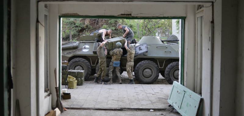"""Servicemen of Ukrainian volonteers battalion of Donbass unload ummunition from Armoured Personnel Carrier (APC) in the village of Shirokine, Donetsk region on June 6, 2015. US President Barack Obama urged fellow leaders of the G7 to stand up to """"Russian aggression in Ukraine"""" as he enjoyed a traditional Bavarian welcome ahead of their summit in Germany. AFP PHOTO/ ALEKSEY CHERNYSHEV        (Photo credit should read ALEKSEY CHERNYSHEV/AFP/Getty Images)"""