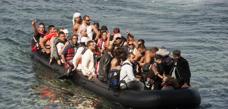 Refugees arrive on the shore of Sykamias beach, west of the port city of Mytilini, after crossing the Aegean sea from Turkey on September 20, 2015 in Lesvos Island, Greece. At least 13 migrants -- six of them children -- drowned off Turkey Sunday after the inflatable dinghy carrying them to Greece was hit in the dark by a Turkish-flagged ship, Turkish media reported. AFP PHOTO / IAKOVOS HATZISTAVROU        (Photo credit should read IAKOVOS HATZISTAVROU/AFP/Getty Images)