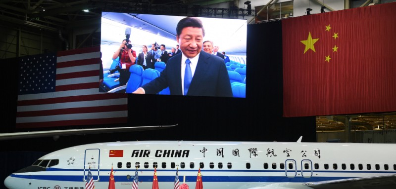 Chinese President Xi Jinping tours a 737-800 at the Boeing assembly line in Everett, Washington. Boeing has reached deals with Chinese firms to sell 300 aircraft and set up a completion center in China, state media and its local partner said Wednesday, as President Xi Jinping began a visit to the United States.          AFP PHOTO / POOL / MARK RALSTON