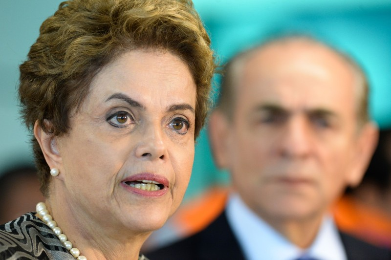 Brazil's President Dilma Rousseff speaks to journalists next to Health minister Marcelo Castro after visiting the National Center for Coordination and Control of Aedes aegypti mosquito, in Brasilia, Brazil on January 29, 2016. AFP PHOTO / ANDRESSA ANHOLETE / AFP / Andressa Anholete        (Photo credit should read ANDRESSA ANHOLETE/AFP/Getty Images)
