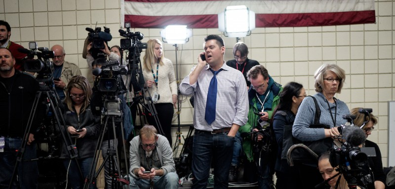 COUNCIL BLUFFS, IA - JANUARY 31: Members of the media watch GOP presidential candidate Donald Trump as he holds a campaign rally at the Gerald W. Kirn Middle School on January 31, 2016 in Council Bluffs, Iowa. Trump and other presidential hopefuls are in Iowa trying to gain support and crucial votes for tomorrow's caucuses. (Photos by Charles Ommanney/The Washington Post via Getty Images)