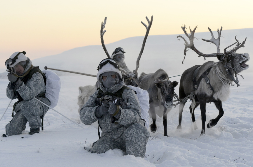 MURMANSK REGION. RUSSIA. FEBRUARY 1, 2016. Reconnaissance unit members of the Northern Fleet's Arctic mechanised infantry brigade conduct military exercises to learn how to ride reindeer sleds at the reindeer farm near the Lovozero settlement. Lev Fedoseyev/TASS (Photo by Lev FedoseyevTASS via Getty Images)