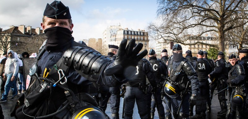 Riot police stand on the Place de la Nation in Paris on February 9, 2016, during a demonstration by non-licensed private hire cab drivers, known in France as VTC (voitures de tourisme avec chauffeur or tourism vehicles with chauffeur). VTC drivers continued a fifth day of protests on February 9 against measures granted by the French prime minister to taxi drivers.  / AFP / Geoffroy Van der Hasselt        (Photo credit should read GEOFFROY VAN DER HASSELT/AFP/Getty Images)