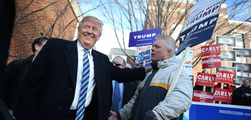 MANCHESTER, NH - FEBRUARY 09:  Republican presidential candidate Donald Trump greets people as he visits a polling station as voters cast their primary day ballots on February 9, 2016 in Manchester, New Hampshire. The process to select the next Democratic and Republican Presidential candidates continues.(Photo by Joe Raedle/Getty Images)