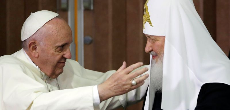 Pope Francis, left, reaches to embrace the head of the Russian Orthodox Church, Patriarch Kirill, during a meeting in Havana on Feb. 12, 2016.