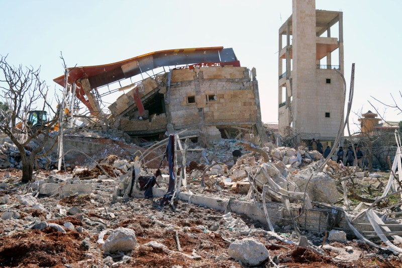 """A picture shows the rubble of a hospital supported by Doctors Without Borders (MSF) near Maaret al-Numan, in Syria's northern province of Idlib, on February 15, 2016, after the building was hit by suspected Russian air strikes.  MSF confirmed in a statement that a hospital supported by the aid group in Idlib province was """"destroyed in air strikes"""". / AFP / STRINGER        (Photo credit should read STRINGER/AFP/Getty Images)"""