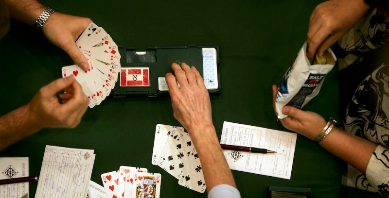 BRIGHTON, UNITED KINGDOM - AUGUST 19:  People play in an open round of Europe's biggest single venue bridge competition at the Metropole Hotel August 19, 2005 in Brighton, England. The game of Bridge is believed to share the same mental ability that is used to trade shares and is played regularly by over a million people.  (Photo by )
