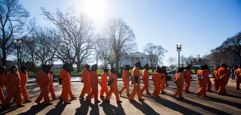 epa05097663 Supporters and members of the activist group 'The World Can't Wait' hold a rally and march asking for President Obama to close the U.S. detention camp at Guantanamo Bay, Cuba across from the White House in Washington, DC, USA, 11 January 2016. The Guantanamo Bay Detention Camp opened 14 years ago today.  EPA/JIM LO SCALZO