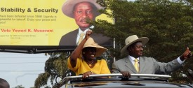 Uganda's incumbent president Yoweri Museveni (R) and his wife Janet Kataha Museveni give the thumbs up to supporters on February 16, 2011 during his last public rally at Kololo Airstrip in Kampala, two days before the general elections. Uganda entered the final day of campaigning today in elections that will likely secure another term for President Yoweri Museveni, already the longest-serving leader in the region.   AFP PHOTO/Simon Maina (Photo credit should read SIMON MAINA/AFP/Getty Images)